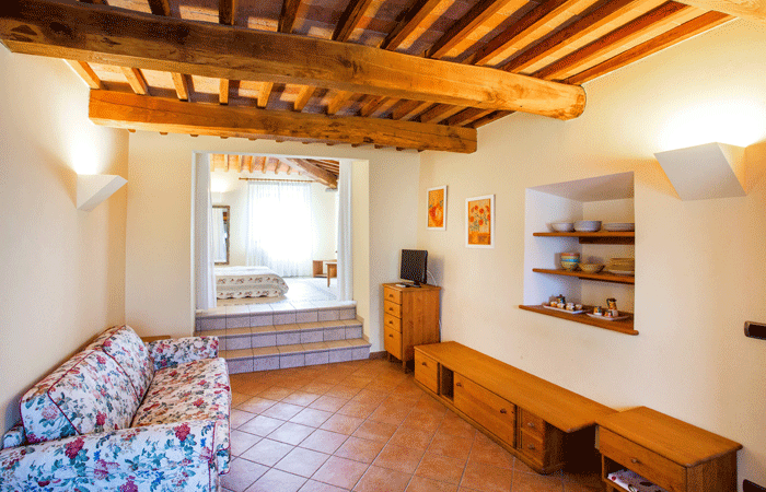 Olive Tree Suites - living room and bedroom, one of the units